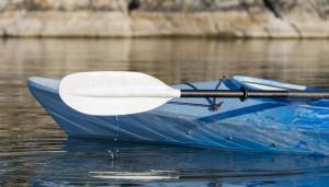 Kayak Paddle With Water Drops Hitting The Lake